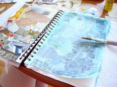 art journal: glue magazine clippings randomly to page; gesso over. Paint wash over gesso. - Casual Crafter