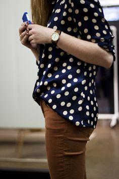 brown pants, navy polka dots.