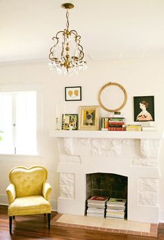 White painted brick fireplace on white wall. Crafty, folk mantle decor. Down & Out Chic