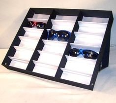 Sunglasses Display Case Stand (hold up to 18pairs) - got mine on ebay for £18.99 including delivery. I will be putting this on a shelf inside my wardrobe/closet and keeping the cases in a storage box. Much easier to choose my sunglasses without opening every single case until I find the right pair. (And no those aren't my sunglasses pictured)