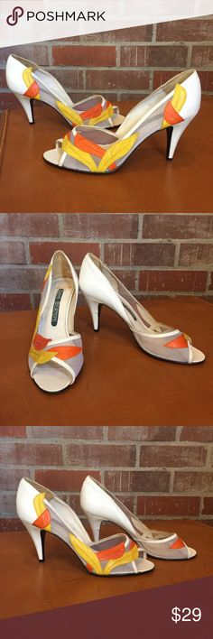 """Fall For Me Mesh Heels These fun peep-toe heels by the vintage brand Giani Bernini are perfect for the summer to fall transition. Details include a beautiful yellow and orange leather design on mesh material for that floating design illusion.  Heel: 3.25"""" Size: 7 Shoes Heels"""