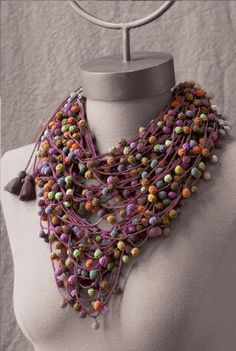 Has the appearace of a neck scarff.  Really cleaver.  This designer is quite talanted.  Valérie Barkowski |Mia Zia - Jewelry
