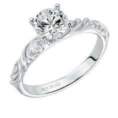 Meet Sunrise. Artcarved Bridal Diamond engagement ring with round center and a satin finished floral carving detail highlighted and accented with diamonds