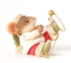 Who doesn't like skating in the winter? This little mouse is using safety pins for his skates; notice the real thread to hold the pins in place. Figurine 1.3 in H