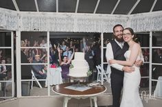 Orcutt Ranch Wedding Photos - You get to cut the cake inside while the guests watch from outside.  Love how this was different!