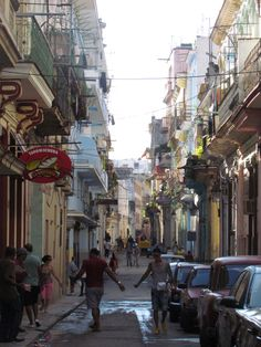 Habana Vieja, Havana, Cuba — by Wandering Tilda. A side street off Calle Obispo in the old part of Havana, Cuba. A beautiful insight into the chaotic inner-city life....