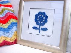 https://flic.kr/p/96p4mw | Crochet Flower Picture | I made this simple flower picture in a gorgeous shade of blue after being inspired by a stunning screen print.  Read the story on my blog:- bunnymummy-jacquie.blogspot.com/2010/12/my-last-ta-dahof-...