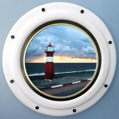 Faux porthole ocean view with lighthouse made by Crones Custom Woodworking.