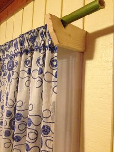 Curtain hardware made of scrap pine and bamboo rods at Easy Tiger Farmstead in Tennessee.