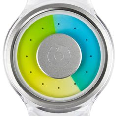 Proton the latest in the collection of timepieces by Hong Kong brand Ziiiro  tells the time using two transparent coloured disks that move over each other as time passes. The appearance of the face changes as the yellow minute disk overlays the blue hour disk to create a green colour.