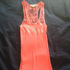 """Coral """"Bride"""" tank top Coral """"bride"""" tank top with lace upper. Perfect for a bachelorette weekend or night out with your favorite ladies. Worn once. Size small. Offers welcome! Tops Tank Tops"""