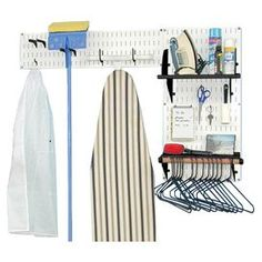 """Laundry room organizer kit with slotted wall panels in white and black.  Product: (1) 32"""" x 16"""" Wall panel (1) 8"""" x 32""""  Wall panel(1) 9"""" x 16"""" Shelf with shelf dividers(1) 4"""" Shelf assembly with dowel rod(2) 3"""" U-hooks(2) 1.25"""" Handle hangers 1 Pack of general purpose hooksConstruction Material: SteelColor: White and blackFeatures:  Made in the USAMagnetic Dimensions: 32 H x 48 W x 9 D (overall)Note: Assembly required"""