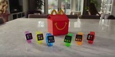 Fitbit Apple Watch and now McDonald's     - CNET  Enlarge Image  Have it your way; then walk it off.                                              McDonalds  The next time your kid opens up her Happy Meal there may be a different type of toy staring back.  McDonalds has begun offering kids in its Canadian restaurants a wrist-worn activity tracker called Step It! as part of its venerable Happy Meal. Its no Apple Watch  the device just counts steps  but its being marketed as McDonalds latest…