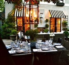Adore these black and white striped awnings