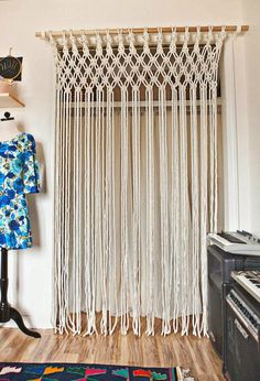 Bustled Blog: Modern Macrame (This is nice, but nothing like the awesome macrame curtains -with plant holders incorporated- that my friend made many years ago).