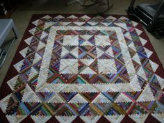 """Click to view large image - Gorgeous scrappy log cabin quilt with blocks set on point. Made by """"dunster"""". From Quilting Board. AWESOME!!!"""