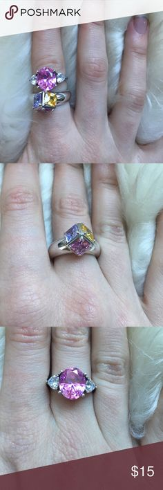 Bundle of 2 sterling silver & colorful stone rings Two sparkly and statement making sterling silver rings. One has a large pink center stone and is flanked by two clear stones. Second ring has a unique triangle setting with purple, yellow, and pink stones. I believe both are a size 7. Some wear and tarnish on both but still in excellent condition and most of the tarnish can probably be cleaned. Jewelry Rings