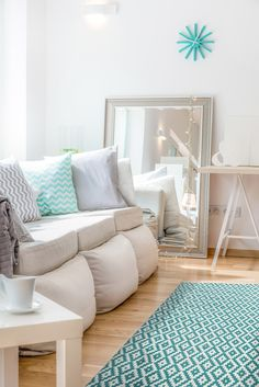Popular The turquoise in the rug is picked out perfectly in the clock and the cushion