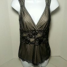 Sexy black lace Deep V neck sleeveless tank. Hit the clubs in  this sexy black top which is new without tags. A stunning wide lace trim accents your waistline. Made of 100 percent nylon. Has a nude lining under the black lace. Comes from a pet and smoke free home. White House Black Market Tops Tank Tops