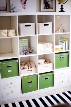 Playroom organization (same Ikea storage I have...like how she changed the knobs to ones from Anthropologie). P.S. The black/white striped rug is amazing!