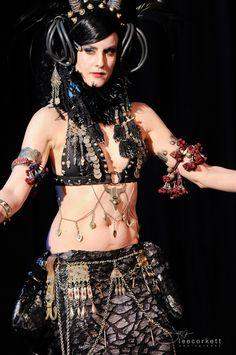 Maureen at Lumen Obscura III dark fusion festival. Costume: gothic horn headdress with rubber tubing. Belt = Victorian antique keys and locks, Turkoman pendants.