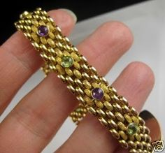 1909 bracelet, olive green peridots and purple amethysts