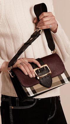 The Buckle Bag in English-woven House check cotton and textured leather from Burberry. Made in Italy, the design has a regimental belt detail with a polished gold metal buckle referencing the trench coat.