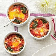 I use fresh salsa instead of jarred spaghetti sauce! Baked Eggs with Spinach and Tomatoes | MyRecipes.com