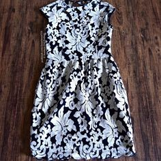 DOLCE VITA Dress Lace Embroidered Homecoming Midi Size XS. New with tags. $198 Retail + Tax.  Gorgeous floral lace cocktail dress featuring an open back and single button closure at neck.  Two pockets at each side. Hidden side zip. Fully lined, excluding open back.  Polyester.  Imported.      ❗️ No trades, holds or modeling.    Bundle 2+ items for a 20% discount!    Stop by my closet for even more items from this brand!  ✔️ Items are priced to sell, however reasonable offers will be…