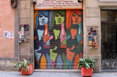 Street art and graffiti on Barcelona's shutter doors.