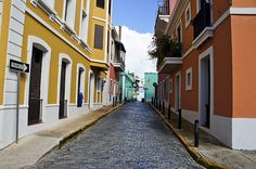 Colorful street lined with houses painted in primary colors in Old San Juan Puerto Rico.