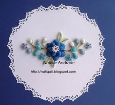 simple blue flower and buds - and by simple I mean the display, not the actual quilling used for this