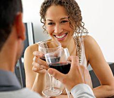 6 Happiest Ways to Beat Belly Fat // Woman drinking wine © Thinkstock