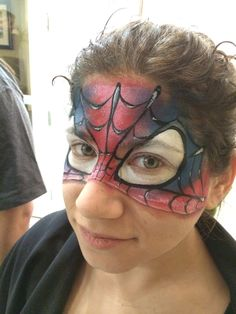 Spiderman face paint with blue and red by Athena Zhe