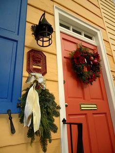 Ohhh here's the orange accent door again in an exterior home paint scheme that includes yellow, bright blue, and white as well. I love it!