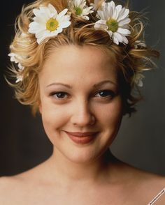 People 1602x2000 women actress blonde short hair Drew Barrymore face portrait looking at viewer smiling brown eyes flower in hair…