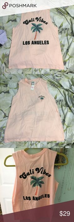 🌴VS PINK muscle tee NWT Gorgeous peach color  Muscle tank  Cali vibes Los Angeles is printed on the back  Sz XS oversized fit   New w tags PINK Victoria's Secret Tops Muscle Tees