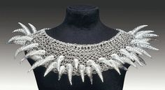 Another exquisite piece from American jewelry & metals artist Arline Fisch (b.1931). 'Silver Anemone' necklace (2001). Fine silver knit, spiral braided cones, 5 x 19 in. Photo: Will Gullette. via Allied Craftsmen