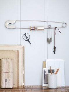 Magnetic wall to save room- can stick scissors, pins, etc.