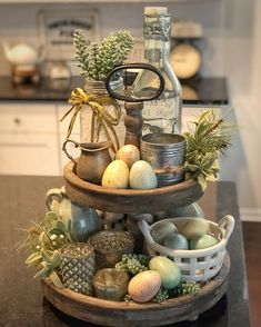 Awesome 35 Trendy Easter Decorations Ideas That Bringing A Farmhouse Appeal To Your Home. # candy quotes 35 Trendy Easter Decorations Ideas That Bringing A Farmhouse Appeal To Your Home - OMGHOMEDECOR Tray Styling, Mason Jar Sconce, Tiered Stand, Spring Home Decor, Spring Kitchen Decor, Easter Table, Easter Eggs, Tray Decor, Deco Table