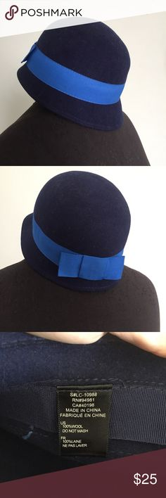 Navy hat with Ribbon from Anthropologie Great little cap hat. Warm and a great alternative to a beanie for the cold. Purchased from anthropologie Anthropologie Accessories Hats
