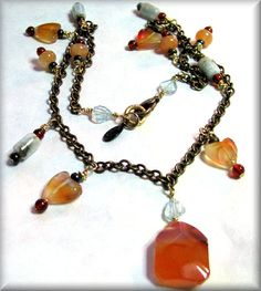This beautiful necklace is designed in complimentary colors with smooth Aquamarine, Agate, Amazonite, Aventurine and Tiger Eye gemstones.  The focal gemstone is a nicely sized, buttery smooth Agate.  The gemstones are wire wrapped by hand on a brass chain using all brass components including the lobster claw clasp.