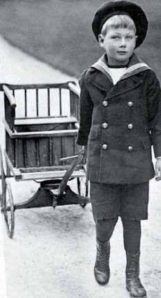When he went out walking, he was tethered by a rope, but he spent his time tending a small garden. He sent the flowers he grew in loving letters to his mother: she never came to see him. The royal drawbridge had been pulled up. At Christmas, John was permitted to be driven to Sandringham for lunch with his family, but then he was driven away again.   One January afternoon in 1919, Prince John suffered his last, massive, epileptic fit and died.      Read more…
