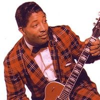 Bo Diddley was born December 30, 1928 as Ellas Bates in McComb, Mississippi. He was an American Rhythm & Blues vocalist, guitarist, songwriter, and inventor who bridged the gap between the Blues and the burgeoning Rock & Roll.