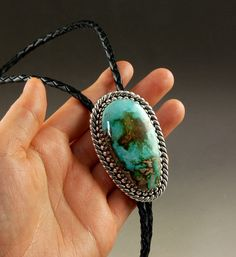 Artisan handmade Sterling Silver bolo tie with two tone Royston Turquoise by John Hartman.