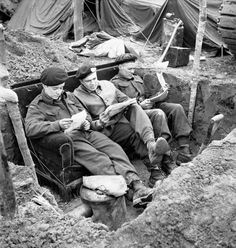 world_war_two - canadian_army - Comfort in the Trenches - Troopers of The Fort Garry Horse reading mail on a couch in their slit trench in the Hochwald, Germany, March (Left To Right): Troopers W. O'Gallagher, L. Nicholas and L. Canadian Soldiers, Canadian Army, Canadian History, British Army, Royal Canadian Navy, War Image, Remembrance Day, Military Photos, History Books
