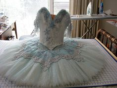 Very light blue with heavy decoration by Ciao Bella.