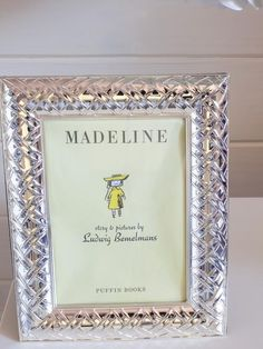 Framing pages from books is a great way to add a sophisticated touch to a youthful subject.  The Art - Dreamy, Sophisticated Toddler Bedroom on HGTV