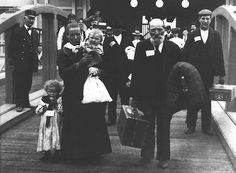 Immigrants Coming to Ellis Island | January 1, 1892: The Ellis Island Immigration Station opens