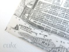 A vintage map of Savannah used in the couple's save-the-dates was printed on vellum and used as a transparent overlay.